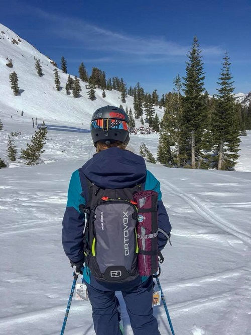 Crazy Creek Hex 2.0 Chair strapped to a backpack on the ski slopes